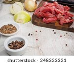 raw meat slices on cutting... | Shutterstock . vector #248323321
