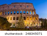 ROME - JANUARY 4: View of the Coliseum at Christmas on January 4, 2015. The Coliseum is one of the most famous monument in the world. - stock photo