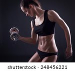 young fit woman lifting... | Shutterstock . vector #248456221