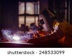 worker welding the steel part... | Shutterstock . vector #248533099