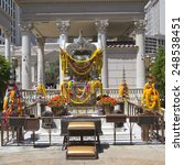 Small photo of LAS VEGAS, NEVADA - MAY 9, 2014: The Shrine of the Four Faced Brahma in the front of Caesars Palace Las Vegas Hotel & Casino