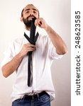 man doing his tie  | Shutterstock . vector #248623585