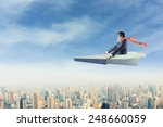 Man On Paper Airplane Above Th...