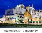 ATLANTIC CITY, NEW JERSEY - SEPTEMBER 8, 2012: Casinos line the Atlantic City boardwalk at dusk. - stock photo