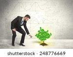 business man watering a growing ... | Shutterstock . vector #248776669
