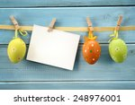 Easter Eggs Hanging On Wood...