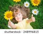happy child lying on grass.... | Shutterstock . vector #248996815