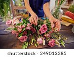 Female Florist Working With...