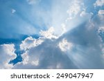 clouds in blue sky with sun rays | Shutterstock . vector #249047947