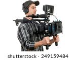 young cameraman with movie camera on the white background - stock photo