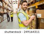warehouse worker scanning box... | Shutterstock . vector #249164311