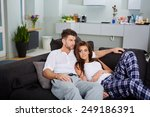 a couple relaxing on a sofa in... | Shutterstock . vector #249186391