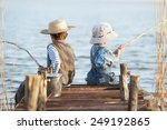Little Boys Is Fishing At...