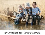 Three Little Boy Is Fishing At...