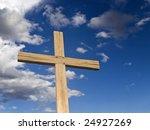 A Wooden Cross Over A Blue Sky...