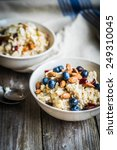 oatmeal with berries and nuts | Shutterstock . vector #249310045