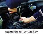 Man Holding A Spanner Over A...