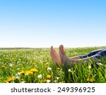 bare feet on spring grass and... | Shutterstock . vector #249396925