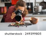 young woman photographing food | Shutterstock . vector #249399805