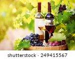 tasty wine on wooden barrel on... | Shutterstock . vector #249415567
