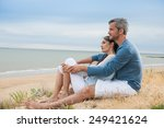 nice couple sitting in the sand ... | Shutterstock . vector #249421624