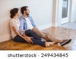Cute Couple Sitting On Floor...