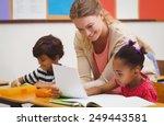 pretty teacher helping pupil in ... | Shutterstock . vector #249443581