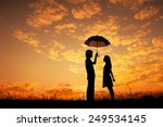 Man And Woman Holding Umbrella...