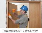 worker fix door hinge with... | Shutterstock . vector #249537499
