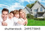happy family near new home.... | Shutterstock . vector #249575845