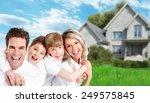 happy family near new home.... | Shutterstock . vector #249575845