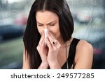 Woman With Cold  Sneezes And...