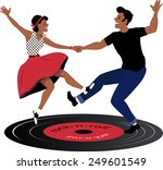 Rockabilly Couple Dancing On A...
