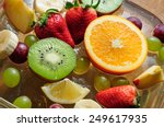 bowl with ice and juicy fruit | Shutterstock . vector #249617935