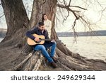 young man playing guitar and... | Shutterstock . vector #249629344