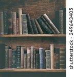 grunge bookshelf with old books. | Shutterstock . vector #249643405