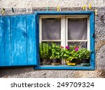 Old Window And Flowers At A...
