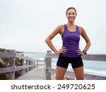 sporty young woman standing on... | Shutterstock . vector #249720625