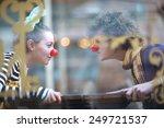 Clowns Facing Each Other ...