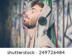 young hipster gay man listening ... | Shutterstock . vector #249726484