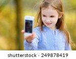 adorable little girl taking a... | Shutterstock . vector #249878419