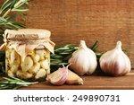 Canned Garlic In Glass Jar On...