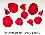wet rose petals on a white... | Shutterstock . vector #249918547