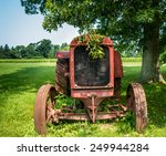 Front View Of An Old Tractor.