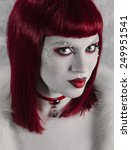 model in red wig with dramatic... | Shutterstock . vector #249951541