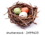 Three speckled eggs in bird's nest over white background - stock photo