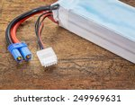 Small photo of Lithium-ion polymer rechargeable battery (abbreviated as LiPo, LIP, Li-poly) with balancing and main power plugs. LiPo batteries are used in portable electronics, drones and radio controlled models.