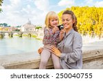mother and baby girl checking... | Shutterstock . vector #250040755