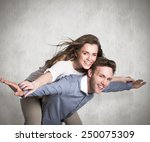 smiling young man carrying... | Shutterstock . vector #250075309