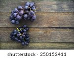 Two Bunches Of Black Grapes On...